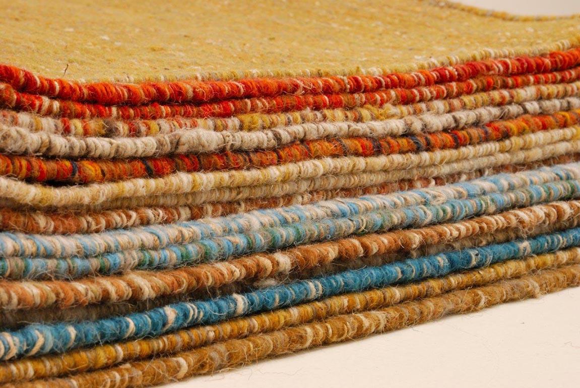 Sajin, tissés mains au Népal, laine Tibetaine et fibre d'ortie.